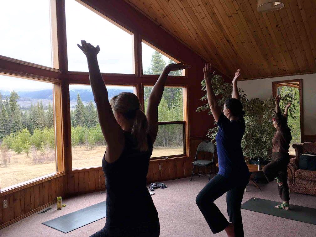 Name, Tammy Rancourt, and Suzanne Ross salute the morning drizzle. Photo and yoga facilitation by Amanda Follett Hosgood
