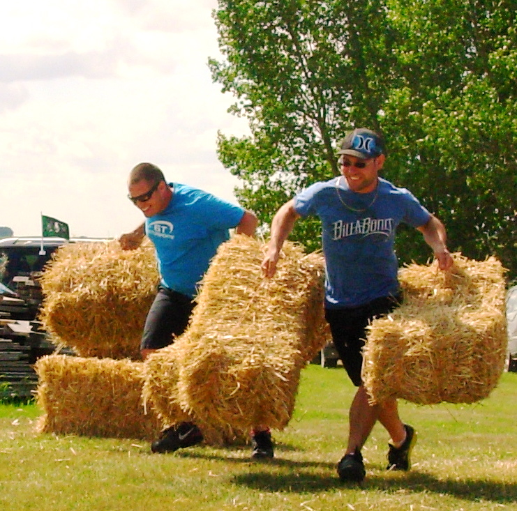 photo of Pete and Tony moving bales