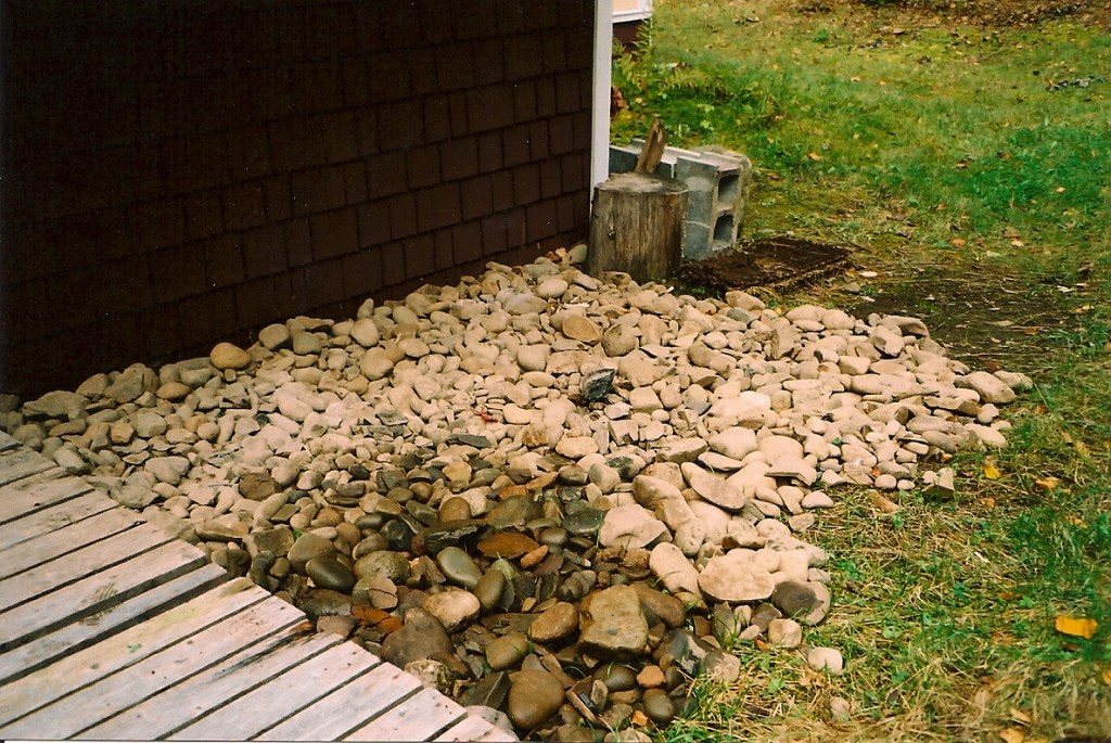 A partial collection of rocks dug out of front bed and transported to back of house, 2004