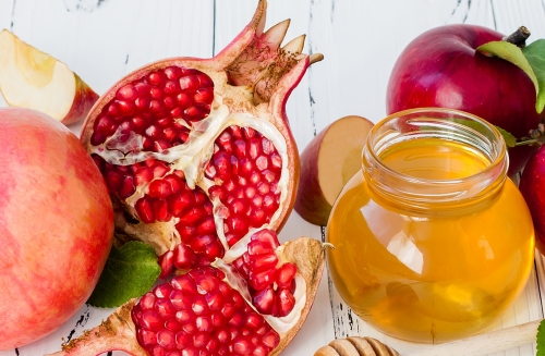 """According to the website I linked above, many Jewish people eat pomegranates at Rosh Hoshanah to give voice to a wish that """"our merits be many like the [seeds of the] pomegranate."""""""